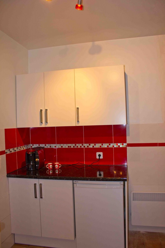 To open out the kitchen, wall units were only placed on one wall.
