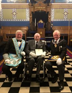 The Worshipful Master With W.Bro Geoffrey William Tuck,PSGD APGM for the Province of Hampshire and the lsle of Wight Presenting a 60 Years In Freemasonry Certificate To Bro David William Alexander Bothwell.